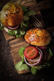 Homemade veggie burger in a bun sesame seeds of beer. Homemade veggie burger in a bun with sesame seeds of beer. delicious fast food for vegans. on a wooden stock image
