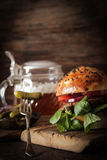 Homemade veggie burger in a bun sesame seeds of beer. Homemade veggie burger in a bun with sesame seeds of beer. delicious fast food for vegans. on a wooden royalty free stock photos