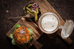 Homemade veggie burger in a bun sesame seeds of beer. Homemade veggie burger in a bun with sesame seeds of beer. delicious fast food for vegans. on a wooden royalty free stock photography