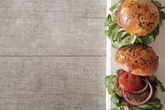 Homemade veggie burger in a bun sesame seeds of beer. Homemade veggie burger in a bun with sesame seeds of beer. delicious fast food for vegans. on a wooden stock images