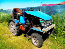 A homemade vehicle, assembled from parts of old cars. The hood and the motor is a homemade vehicle, assembled from parts of old cars. Parked at the fence Stock Photo