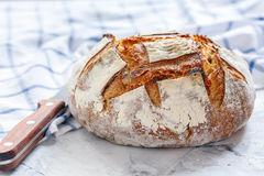 Homemade Vermont sourdough bread from wheat and rye. Vermont sourdough bread from wheat and rye on a linen towel Royalty Free Stock Photo