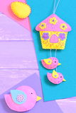 Homemade vibrant felt Easter diy on wooden background with empty copy space for text Royalty Free Stock Image