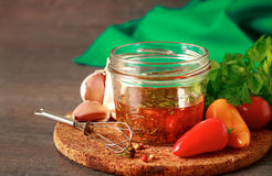 Homemade vinaigrette with fresh ingredients. Salad dressing with olive oil, honey, lemon and herbs Royalty Free Stock Photos