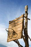Homemade vintage backboard. Of wood planks with rusted nails and rusted basket for basketball play in a poor rural Western village Royalty Free Stock Images