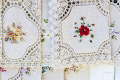 Homemade vintage tablecloths in open market. Handmade vintage tablecloths in open market royalty free stock photography