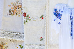 Homemade vintage tablecloths in open market. Handmade vintage tablecloths in open market Royalty Free Stock Photo