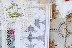 Homemade vintage tablecloths in open market. Handmade vintage tablecloths in open market stock images