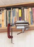 Homemade vise on the bookshelf Royalty Free Stock Photos