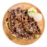 Homemade waffle with ice cream and chocolate sauce Stock Images