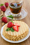 Homemade waffle with strawberry on a wooden surface Stock Images