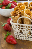 Homemade waffle with strawberry on a wooden surface Stock Photography