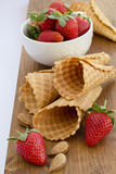 Homemade waffle with strawberry on a wooden surface Stock Photos