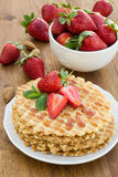 Homemade waffle with strawberry on a wooden surface Royalty Free Stock Photo
