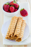 Homemade waffle with strawberry on a wooden surface Stock Image