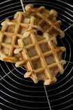 Waffles on wire grill Royalty Free Stock Images