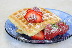 Homemade waffles and berries royalty free stock photos