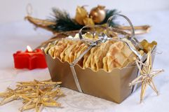 Homemade waffles for Christmas. And New Year gift in a golden box, arranged with festive decoration Stock Photography