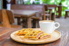Homemade waffles with hot coffee on wooden plate. Stock Photography