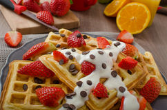 Homemade waffles with maple syrup and strawberries Royalty Free Stock Photo