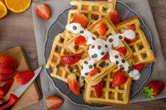 Homemade waffles with maple syrup and strawberries Stock Images