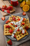 Homemade waffles with maple syrup and strawberries Stock Image