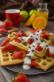Homemade waffles with maple syrup and strawberries Royalty Free Stock Photos