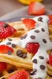 Homemade waffles with maple syrup and strawberries Royalty Free Stock Photography