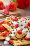 Homemade waffles with maple syrup and strawberries Royalty Free Stock Images