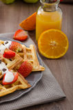 Homemade waffles with maple syrup and strawberries Royalty Free Stock Image
