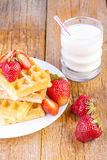 Homemade waffles with strawberries and milk Royalty Free Stock Photo