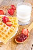 Homemade waffles with strawberry jam Royalty Free Stock Photos