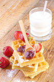 Homemade waffles with strawberry jam Royalty Free Stock Photos