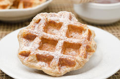 Homemade waffles topped with powdered sugar for breakfast Stock Photos