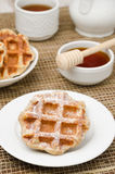 Homemade waffles topped with powdered sugar for breakfast Royalty Free Stock Image