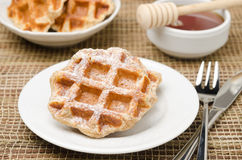 Homemade waffles topped with powdered sugar for breakfast Royalty Free Stock Photography