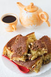 Homemade Walnut Cake with Coffee. Homemade Walnut Cake with a Cup of Coffee, a Teapot and a Red Spoon Royalty Free Stock Image
