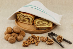 Homemade walnut loaf. Home made traditional hungarian walnut loaf roll on vintage table cloth Stock Photos