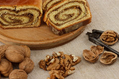 Homemade walnut loaf. Home made traditional hungarian walnut loaf roll on vintage table cloth Stock Photo