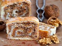 Homemade walnut strudel and walnuts Royalty Free Stock Image