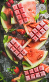 Homemade watermelon strawberry popsicles on ice with fresh fruits Stock Photo