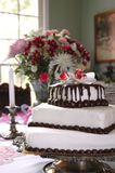 Homemade Wedding Cake. The bride made her wedding cake, displayed in the home of the wedding hosts royalty free stock image