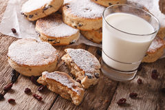 Homemade Welsh cakes with raisins and milk close-up. Horizontal Royalty Free Stock Image