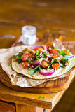 Homemade wheat flat bread with fresh chard leaves, roasted cherry tomatoes Stock Images