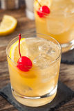 Homemade Whiskey Sour Cocktail Drink. With a Cherry Lemon Stock Image