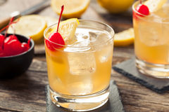 Homemade Whiskey Sour Cocktail Drink. With a Cherry Lemon stock images