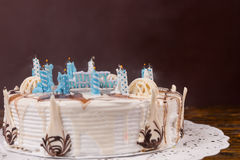 Homemade white birthday pie with lots of extinguished candles Stock Photo