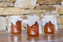 Homemade white cherry  jam in glass jars. Royalty Free Stock Photos