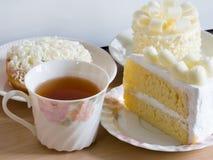 Homemade white chocolate cakes , selective focus. White chocolate cakes with beautiful cup of herbal tea Stock Image