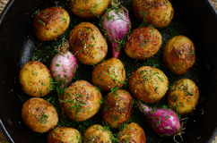 Homemade whole fried young potato and onion Royalty Free Stock Photos